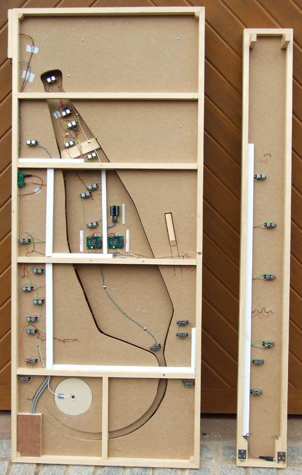The unserside of both baseboards showing the cut outs in the MDF, point notors and DCC operating modules.